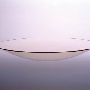 Okrągły panel z ceramiki szklanej do pieców i kominków w postaci sferycznej fot. Schott